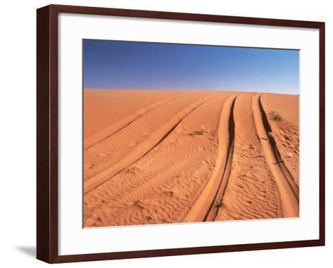 Tyre marks in the desert--Framed Art Print