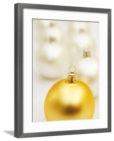 White Christmas tree decorations and a yellow one--Framed Art Print