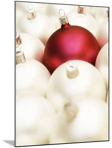 White Christmas tree decorations and a red one--Mounted Photographic Print