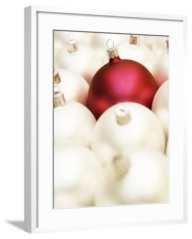White Christmas tree decorations and a red one--Framed Art Print
