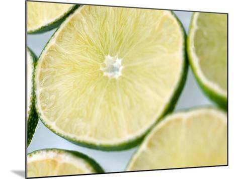 Limes in slices--Mounted Photographic Print