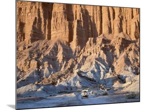 SUV Driving Through Valley of the Moon-Hubert Stadler-Mounted Photographic Print