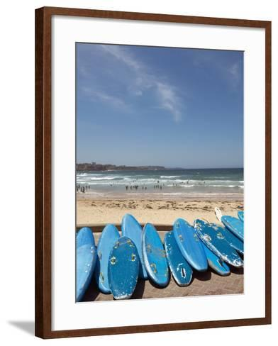 View of stacked up surfboards at the beach--Framed Art Print