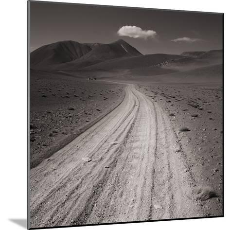 Road leading through desert setting--Mounted Photographic Print
