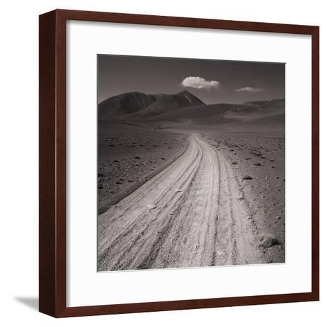 Road leading through desert setting--Framed Art Print