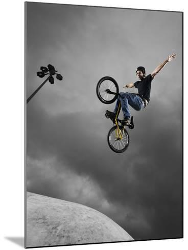 BMX Biker Performing Tricks--Mounted Photographic Print