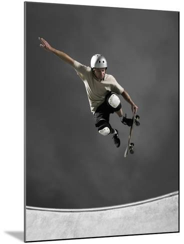 Skateboarder Performing Tricks--Mounted Photographic Print