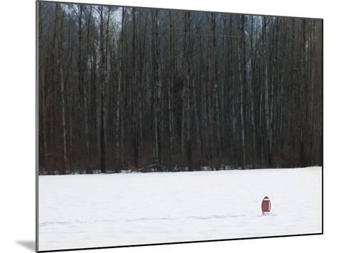 Football in Snow Covered Field--Mounted Photographic Print