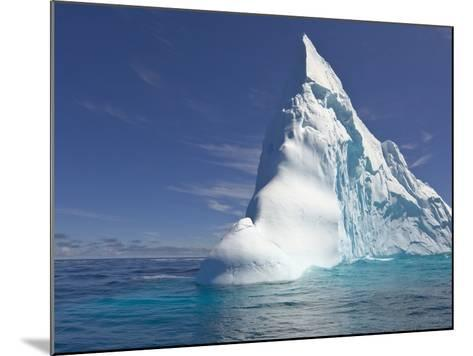 Pointy Blue Iceberg Sculpted by Waves-John Eastcott & Yva Momatiuk-Mounted Photographic Print