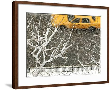 Yellow cab on Park Avenue in a snowstorm-Bo Zaunders-Framed Art Print