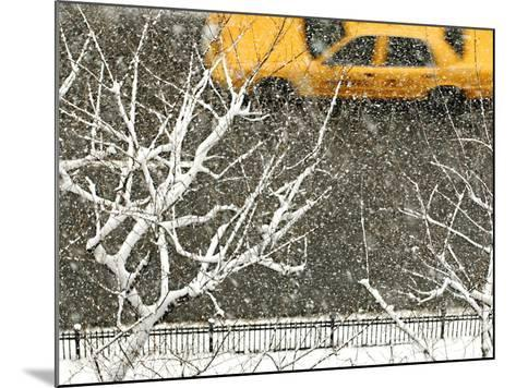 Yellow cab on Park Avenue in a snowstorm-Bo Zaunders-Mounted Photographic Print