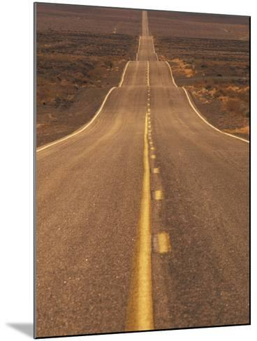 USA, California, Death Valley- Long Shot of Desert Highway-Chris Cheadle-Mounted Photographic Print