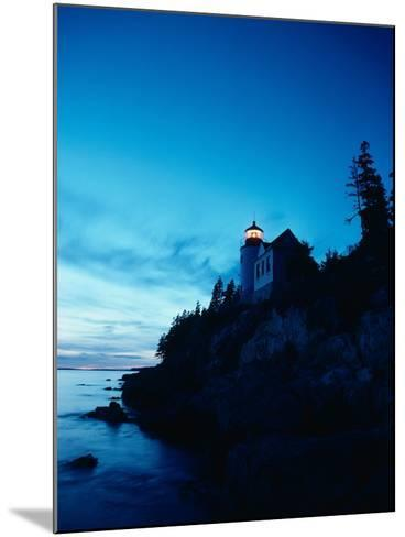Lighthouse at Dusk-Craig Aurness-Mounted Photographic Print