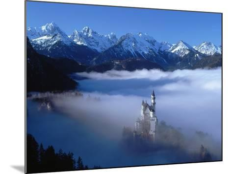 Neuschwanstein Castle Surrounded in Fog-Ray Juno-Mounted Photographic Print