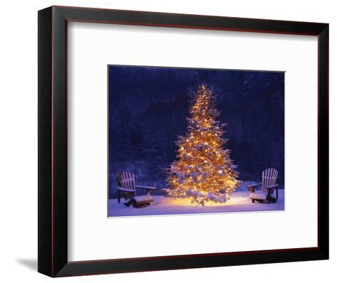 snow covering adirondack chairs by lit christmas tree jim craigmyle framed art print - Decorating Adirondack Chairs For Christmas