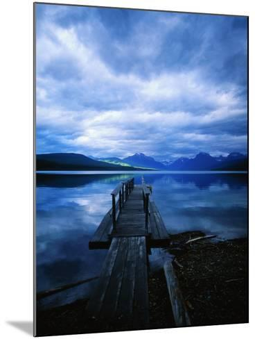 Pier at Lake McDonald Under Clouds-Aaron Horowitz-Mounted Photographic Print