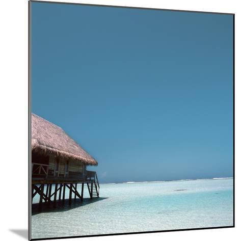 Beach Hut Over Shallow Water--Mounted Photographic Print