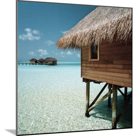 Cabana Raised Above the Ocean--Mounted Photographic Print