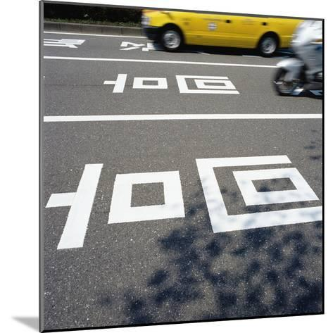 Road markings on a Japanese street--Mounted Photographic Print