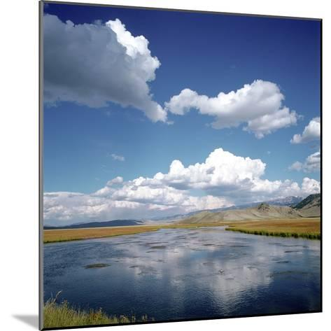 River Running Through Countryside--Mounted Photographic Print