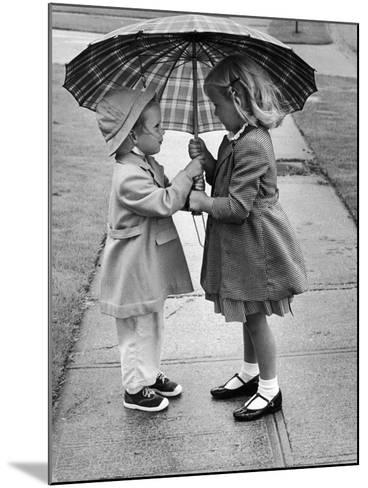 Girls Sharing an Umbrella-Josef Scaylea-Mounted Photographic Print