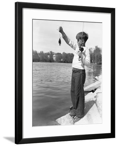 Boy Holding a Small Fish-Philip Gendreau-Framed Art Print