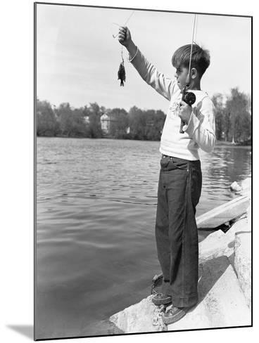 Boy Holding a Small Fish-Philip Gendreau-Mounted Photographic Print