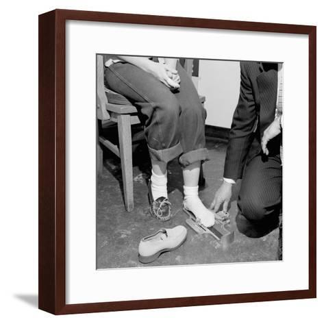 Salesmen Helps Woman with Safety Work Shoes, Ca. 1943--Framed Art Print