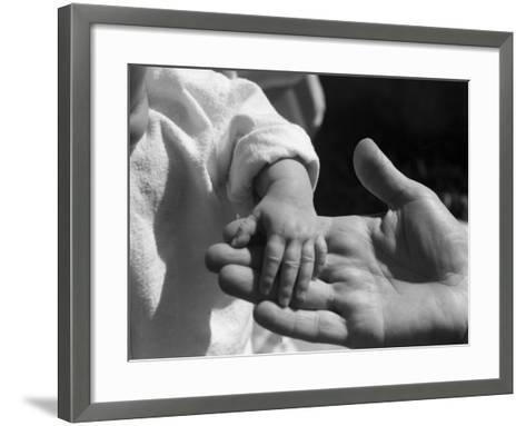 Infant's Hand in Man's Hand-Philip Gendreau-Framed Art Print
