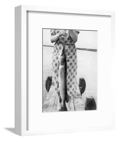 Woman Holds on Large Northern Pike on a Lake Pier, Ca. 1950--Framed Art Print
