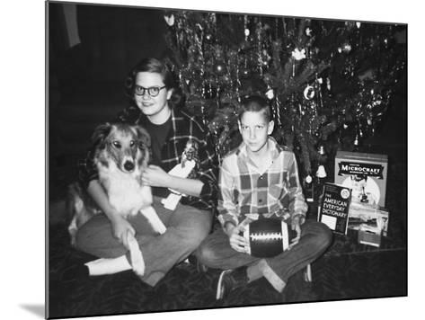 Brother and Sister Pose by the Christmas Tree, Ca. 1960--Mounted Photographic Print