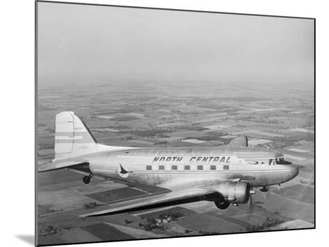 Douglas Dc-3 Plane in Flight--Mounted Photographic Print