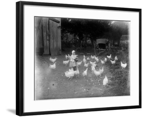 Girl Feeding Chickens--Framed Art Print