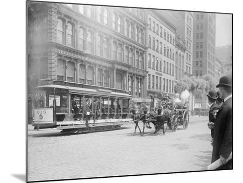 Fire Engine Being Pulled by a Horse--Mounted Photographic Print