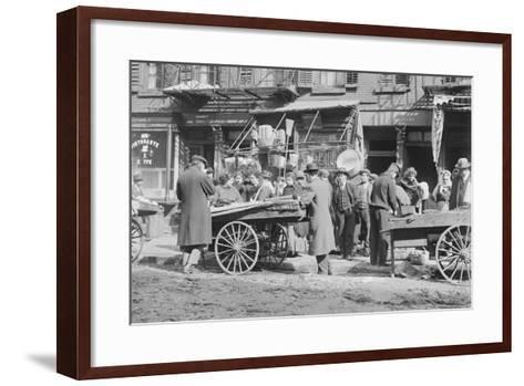 People Shopping around Push Cart--Framed Art Print