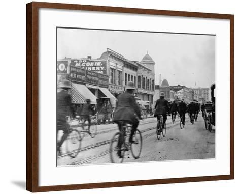 Los Angeles Police Officers Bicycling Past Broadway Storefronts--Framed Art Print