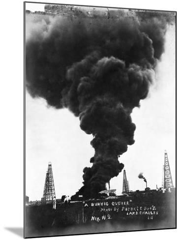 Smoke Billowing from an Oil Well Fire--Mounted Photographic Print