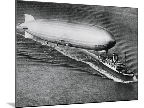 Graf Zeppelin Flying Above the S.S. New York--Mounted Photographic Print