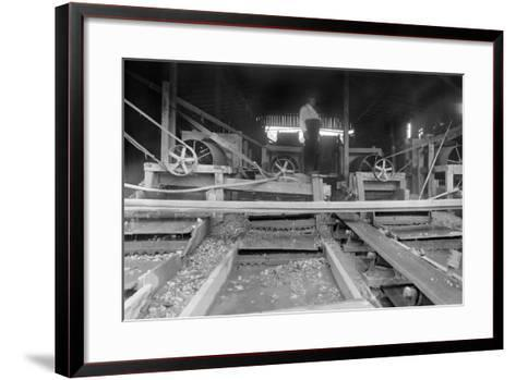 A Worker Stands over a Rock or Gravel Processing Facility, Ca. 1910--Framed Art Print