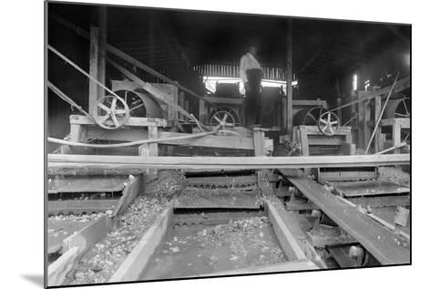 A Worker Stands over a Rock or Gravel Processing Facility, Ca. 1910--Mounted Photographic Print