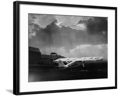 """Amy Johnson's """"The Desert Cloud"""" Preparing for Take Off--Framed Art Print"""