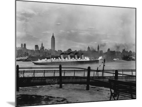 The S.S. Mauretania and New York City Skyline--Mounted Photographic Print