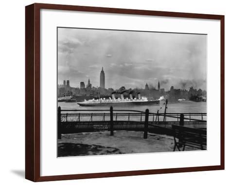 The S.S. Mauretania and New York City Skyline--Framed Art Print