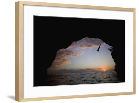 Young Man Diving into Sea at Pirate's Cave-Paul Souders-Framed Art Print
