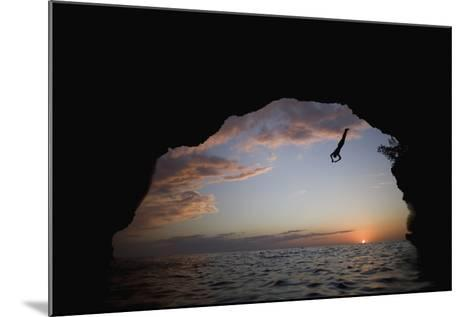 Young Man Diving into Sea at Pirate's Cave-Paul Souders-Mounted Photographic Print