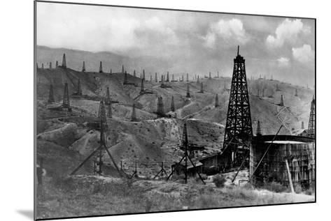 Oil Rigs Near Taft, California--Mounted Photographic Print