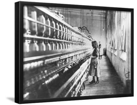 Girl at Spinning Machine-Lewis Wickes Hine-Framed Art Print