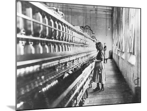 Girl at Spinning Machine-Lewis Wickes Hine-Mounted Photographic Print