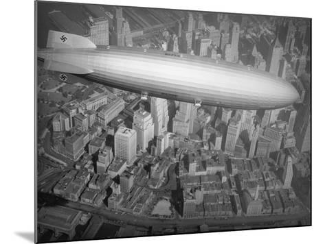 Hindenburg Flying over Manhattan--Mounted Photographic Print