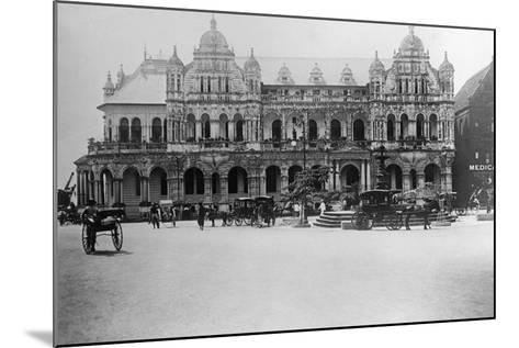 Exterior of Large Bank with Carriages in Front--Mounted Photographic Print